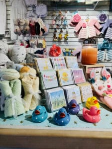 Baby shower cards and bath toys on the counter of children's store, Mara Luna.