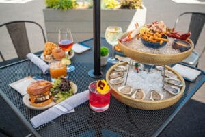 Seafood Dishes at outdoor dining table at Lil' Sis
